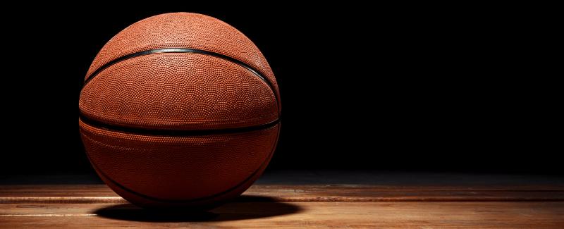 Basketball with dramatic lighting