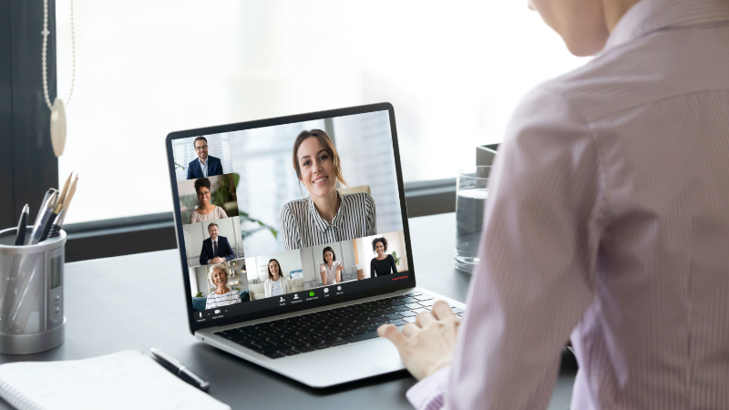 laptop with a team meeting on screen