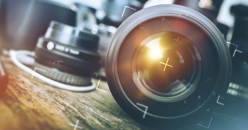 Close up of a camera lens on a table.