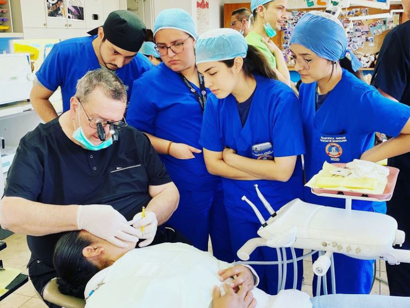 Dr. Everett Heringer demonstrating for students from Mariano Galvez University at Peronia, Guatemala, during the February volunteer trip.