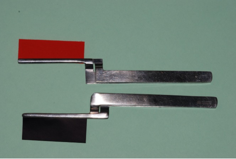 Tools with contact papers, one in red and one in black.